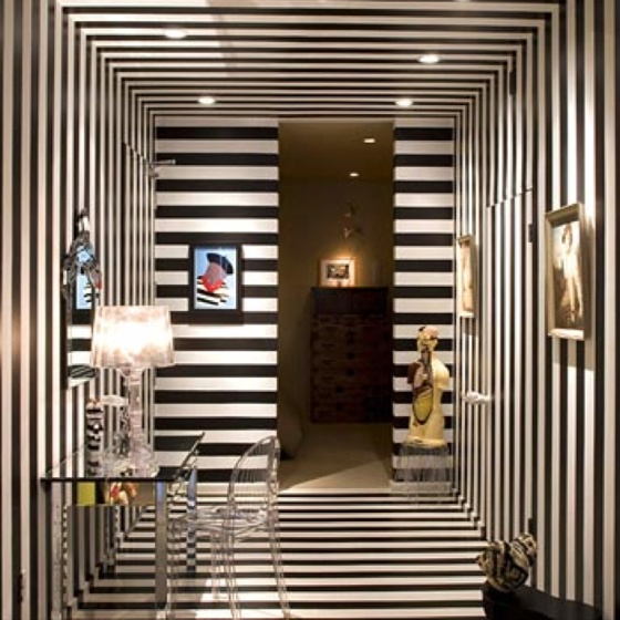borderline vertigo, but reminds me of a chic city apartment foyer...glam w Lucite and mirrors and silver/chrome