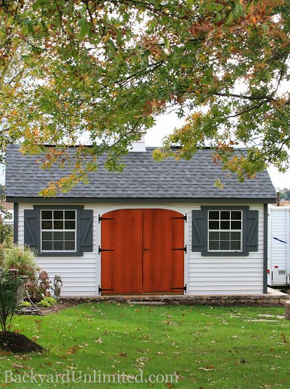 "12'x16' Garden Shed with Rounded Door, 12"" Strap Hinges, Vinyl Siding, Ridge Vent, Gable Vent, Cupola and Shutters http://www.backyardunlimited.com/sheds/garden-sheds"