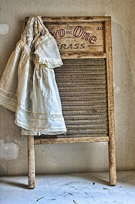 Old wash board and child's dress.