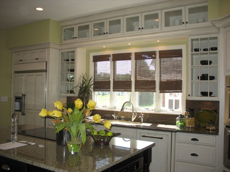 Love the use of the glass cabinets all around the kitchen window.