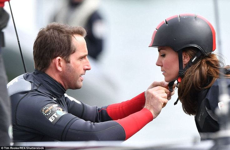 Helping hand: Sir Ben assisted the Duchess before embarking on the thrilling high-speed ride in a racing yacht