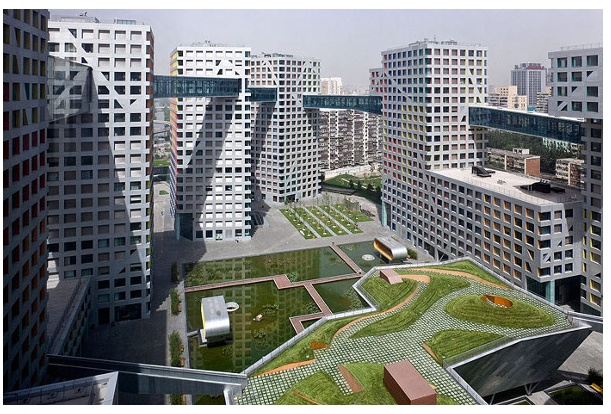 """At 220,000 square meters  this sustainable community in Beijing China is supported by a geothermal system and is aiming to be the world's largest green residential project. """"An open city within a city"""" it includes 750 homes and was designed by Steven Holl Architects."""