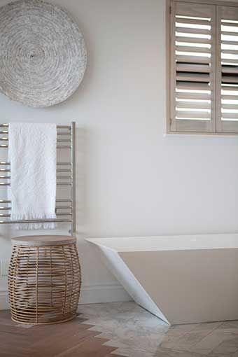 Michele Throssell Interiors > Beach house > Laid back, casual, comfortable textured interiors > Interior design > main ensuite bathroom > freestanding bath tub > herringbone marble & wood flooring