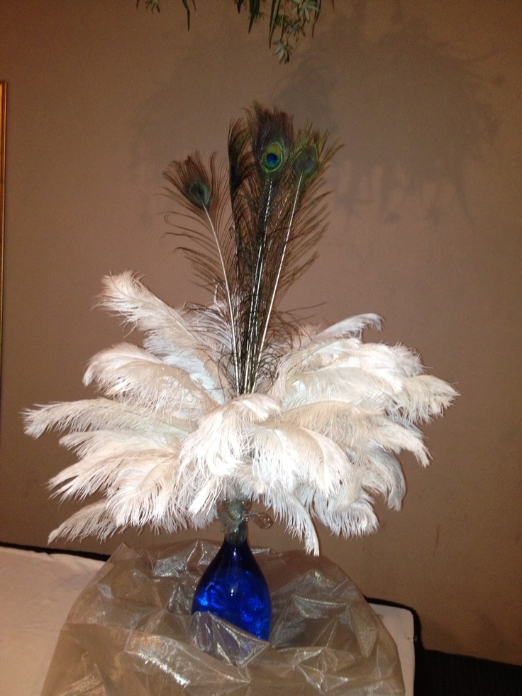 Peacock and ostrich feather centerpiece peacocks rock