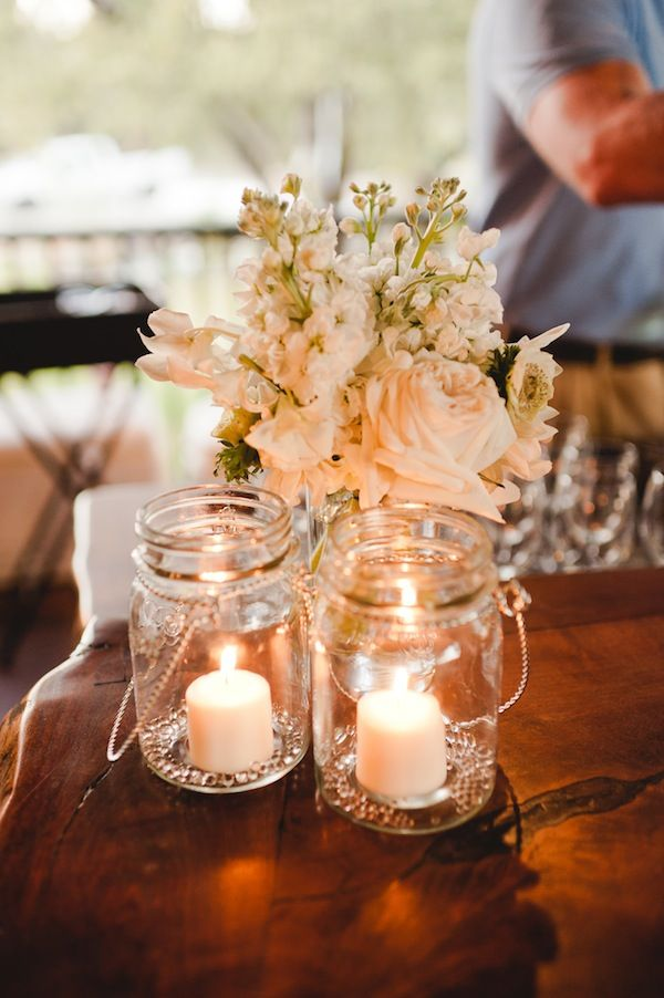 Reception nosegays with mason jars for a vineyard wedding.
