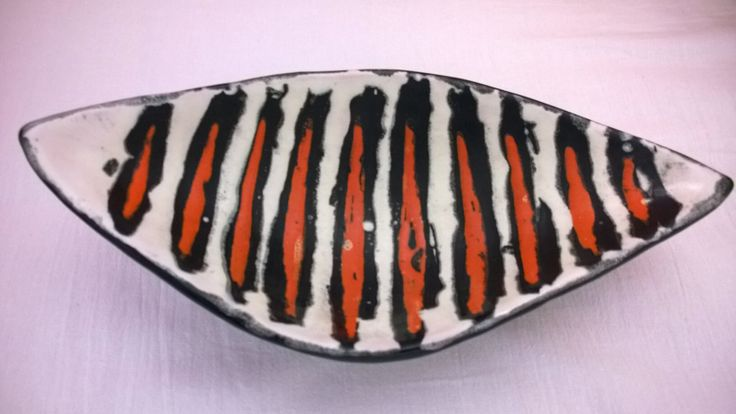 Little plate with orange stripes.