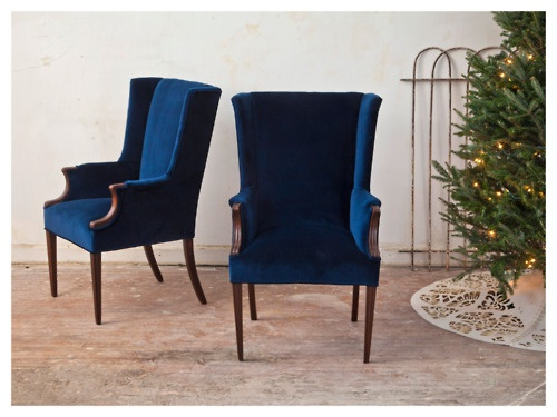 Vintage velvet pair, after! We refinished the wood and transformed this pair with beautiful new midnight blue velvet.