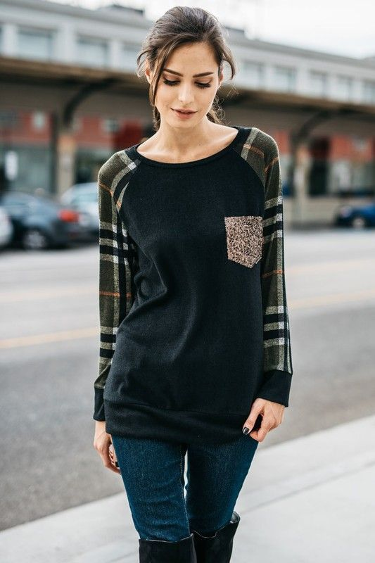 Plaid and glitter have never looked better together. This cozy women's tunic top adds some glam with a sequin front pocket. And the plaid sleeves add a festive touch. Fabric is opaque with stretch. -