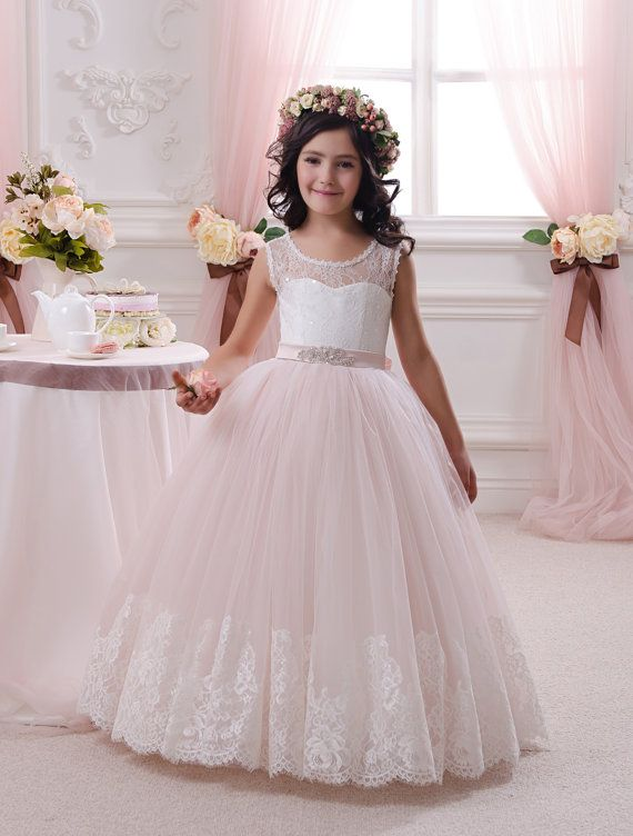 Please read our store policies before placing your order here https://www.etsy.com/ru/shop/Butterflydressua/policy Gorgeous ivory and blush pink flower girl dress with multilayered skirt, lace corset with applique and rhinestones, and satin stripe. Item material: upper layer of the skirt- tulle with lace applique middle layer of the skirt- tulle lower layer of the skirt- taffeta corset- lace, satin with rhinestones Dress color: ivory and blush pink ivory white Size: 2-3-4-5-6-7-8-9-1...