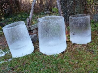 Ice Luminaires to light the way down the garden path - a large candle makes these glow and as long as the weather stays cold, my beautiful ice candle holders will remain intact.