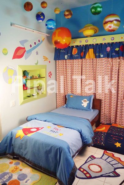 Some of the room would be to young but I bet Liam would love have the planets over his head like this..
