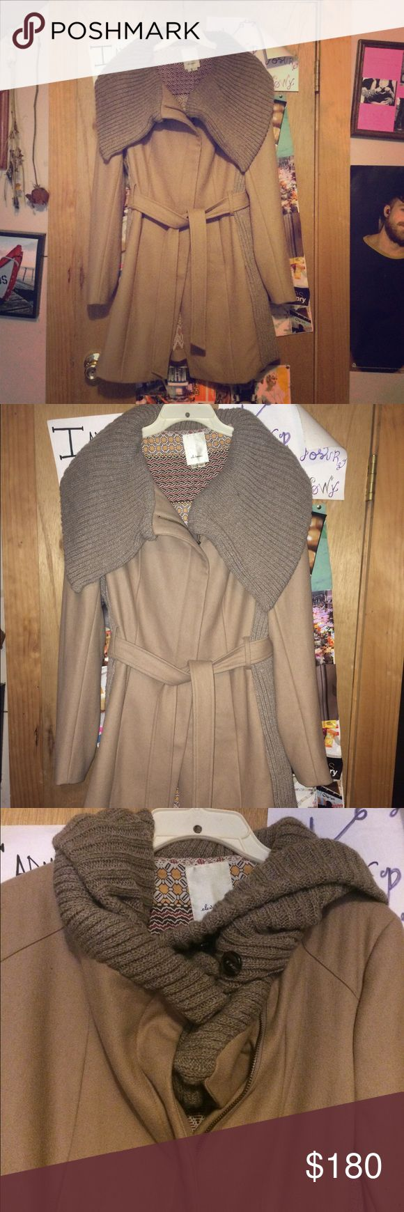 Anthropologie beige zip up winter pea coat 14 Anthropologie - brand: Elevenses. Worn only once. Excellent practically new condition. Super warm with a soft sweater material collar. Collar can be tucked in for a scarf look. With belt. Sweater material down sides. Sweater on sides is just a top layer. Fully lined. Zip up. Knee length. Front pockets. Size 14, normally I'm a 12 and fits perfect. No longer in stores Anthropologie Jackets & Coats Pea Coats
