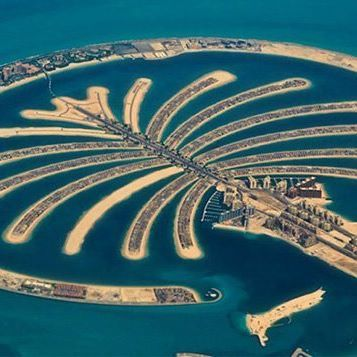 A Palm  shaped man made island .  The Palm Jumeirah is an artificial man made island in United Arab Emirates, created using land reclamation by Nakheel, a company owned by the Dubai government, and designed and developed by Helman Hurley Charvat Peacock/Architects, Inc. It is located on the Jumeirah coastal area of the emirate of Dubai, in the United Arab Emirates #. The monorail  connects the Palm Jumeirah to the mainland. Palm Jumeirah Monorail is a 5.4-kilometre-long connectin...