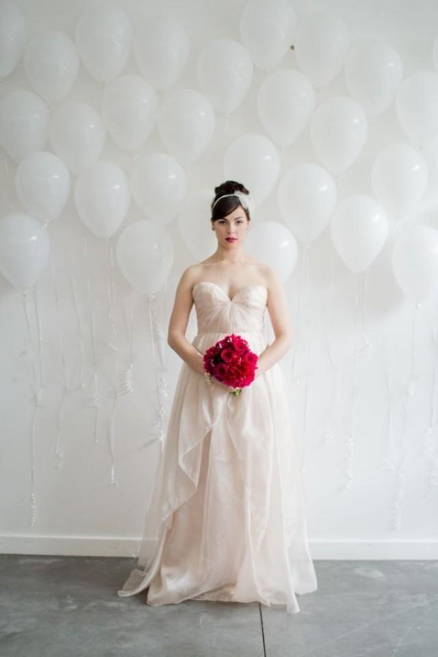 balloon backdrop // photo by Samantha Cabrera // View more: http://ruffledblog.com/hot-pink-wedding-inspiration/