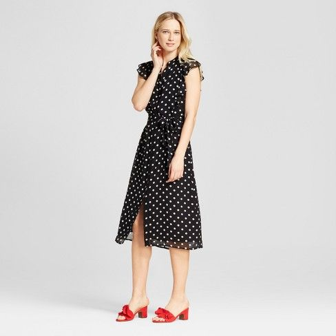 Add a frilled detail for an inherently girly vibe with the Ruffle Sleeve Midi Dress - Who What Wear™. The flirty flip of the full skirt hits at the perfect point on your calf for wearing with everything from sandals to booties to tall boots; simple notched collar draws the eye upward for a face-flattering effect.