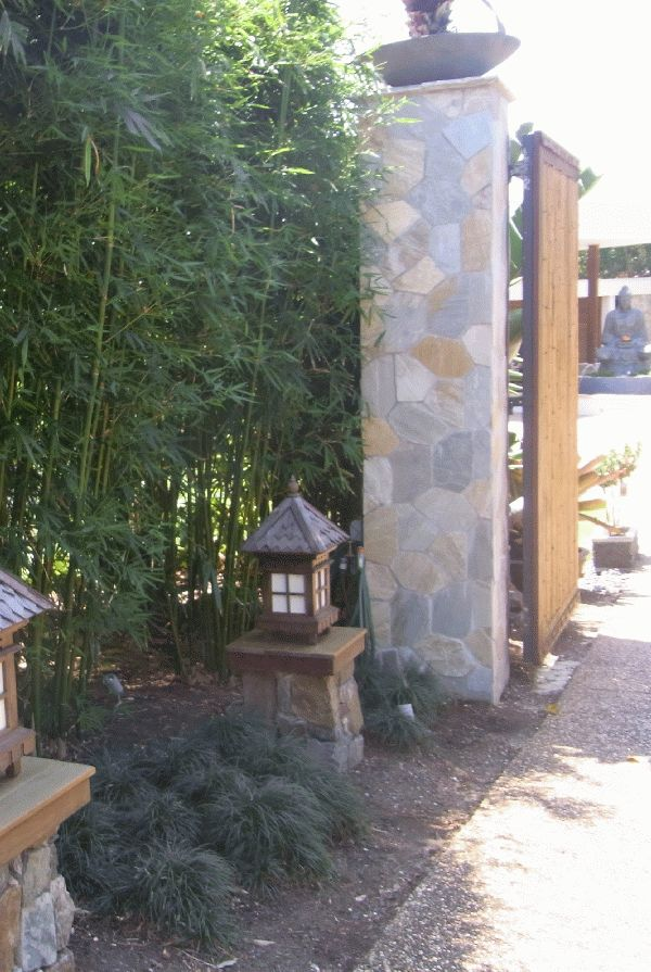 From the very moment I approached the gates the modern feel of this family garden was apparent.  The stone pillars and timber gates with the bamboo hedges and little stone lanterns are simple and very loved.