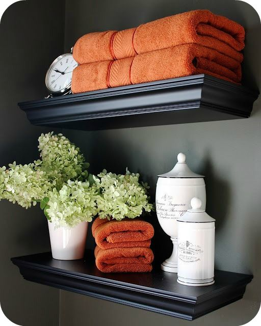 Bathroom shelving decor... I love the hydrangeas and folded towels.