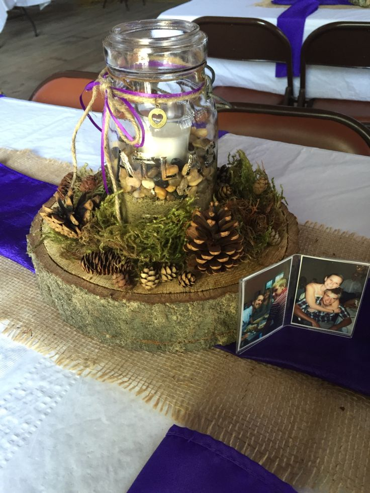 Wood chunk, mason jar with rocks and moss and pinecone centerpieces