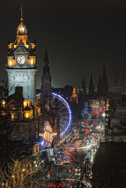 Edinburgh at night. The bright, colorful lights are so seductive to me.