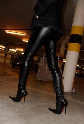 6 inch stiletto high heels and dresses in skintight black leather