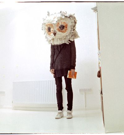 I like the the use of the over sized owl mask. It relates to my piece because they are disguising themselves with mask.