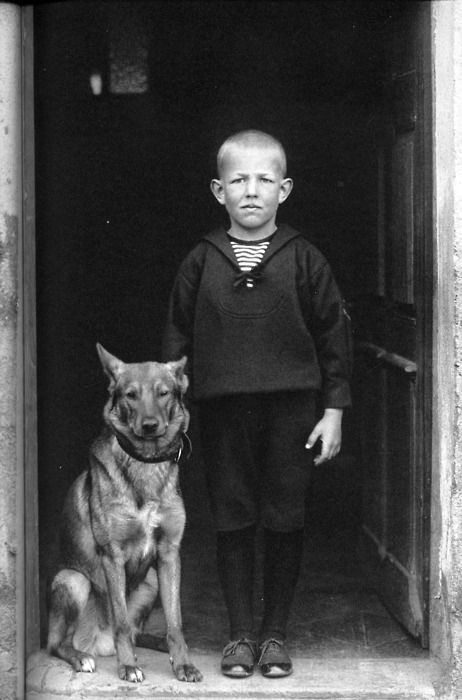 © August Sander. A boy and his shepherd.