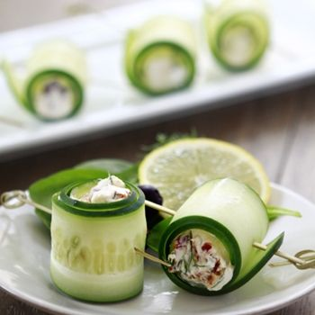 Clean Eating Snacks:  Cucumber Feta Rolls... 2 cucumbers  6 ounces crumbled feta  3 tablespoons Greek yogurt  2 1/2 - 3 1/2 tablespoons finely diced sundried tomatoes or red bell pepper  8 - 12 pitted kalamata olives, roughly chopped  1 tablespoon roughly chopped dill or oregano  2 teaspoons lemon juice  pinch of pepper, or to taste
