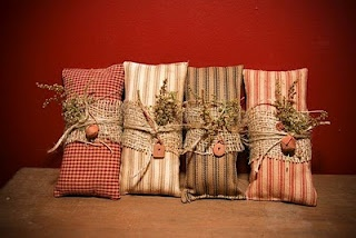 Mini primitive pillows.....they are stained....wrapped with a piece of burlap....tied with twine....a little sprig of something nice tucked in....make a great little gift....love them