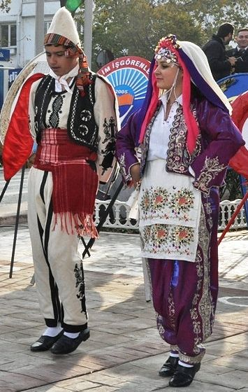 Traditional festive female costume from the district of Keşan (in the southern part of the Edirne province).  'Rumeli'-style: 1900-1950.  The 'şalvar' (baggy trousers) and 'cepken' (long-sleeved vest) embroidered are in silk and silvery metal thread.  An embroidered 'makrama' (napkin) is worn as apron (which is current in Thrace and northwestern Anatolia).  This is a (good) recent workshop-made copy, as worn by folk dance groups.