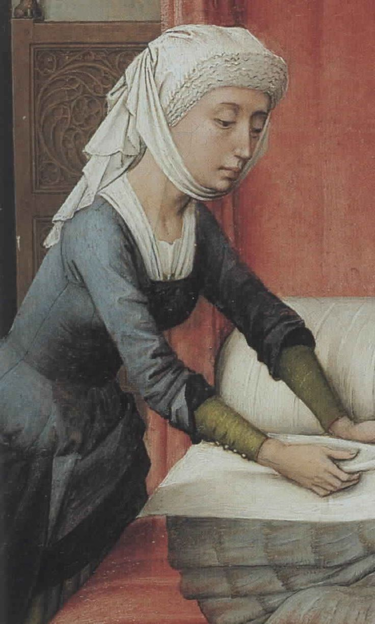 Nifty sleeve configuration, excellent detail in the seaming and shoulder attachment.  No visible front closure?  (From VDW's St John altarpiece).