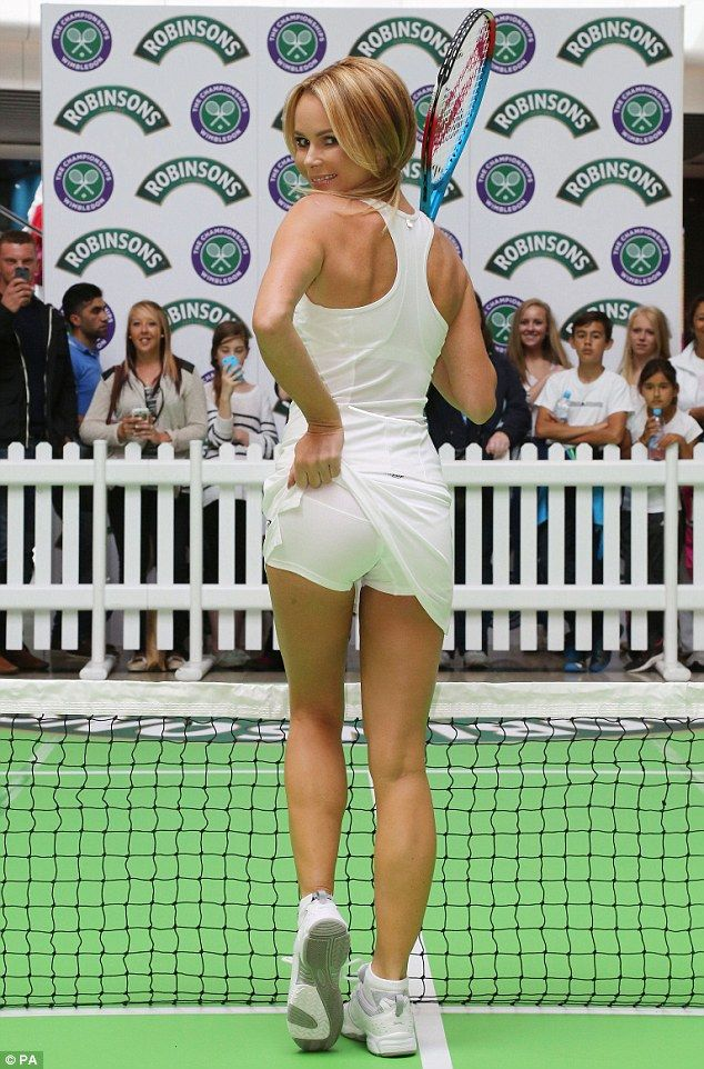 Cheeky! Amanda Holden flashes her control pants as she launches a pop-up tennis court in Westfield Stratford in East London