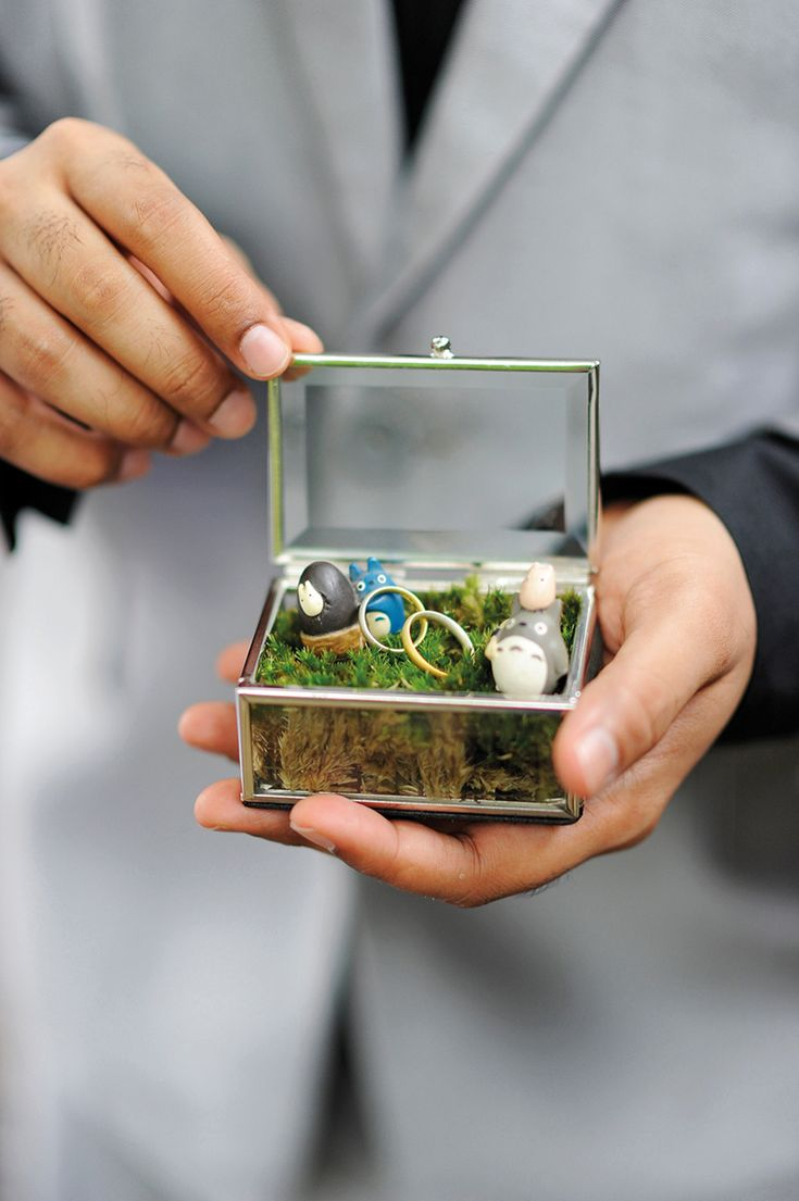 Real couple Yuling and Anders' adorable glass ring box filled with moss and Totoro figurines. http://www.herworldplus.com/weddings/real-weddings/weddings-singapore-and-sweden-how-one-bride-had-beautiful-celebrations-2