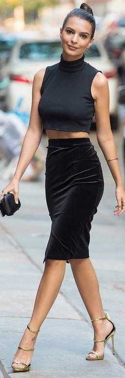 Who made Emily Ratajkowski's jewelry, velvet skirt, gold sandals, and black turtleneck top?