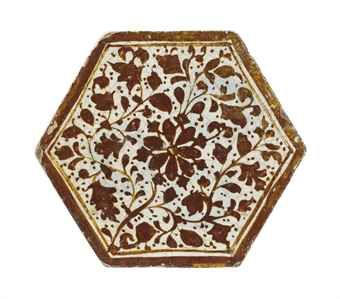 A HEXAGONAL LUSTRE POTTERY TILE PROBABLY TIMURID IRAN, 15TH CENTURY