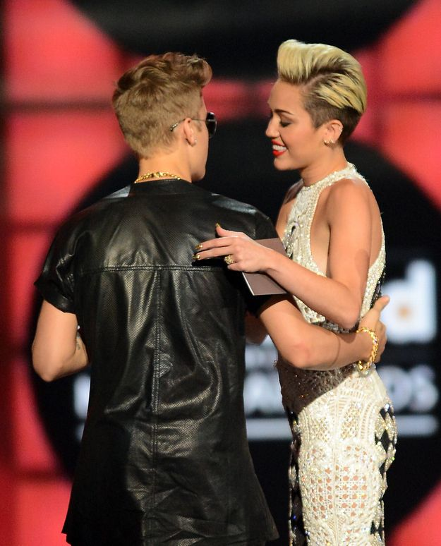 Justin Bieber And Miley Cyrus Have The Same Haircut  They were on the stage at the same time at the Billboard Music Awards and you couldn't help but notice the similarities.