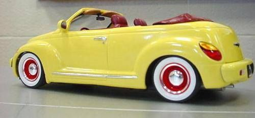PT Cruiser rodder convertible. Looks like something from Roger Rabbit. Adorable.