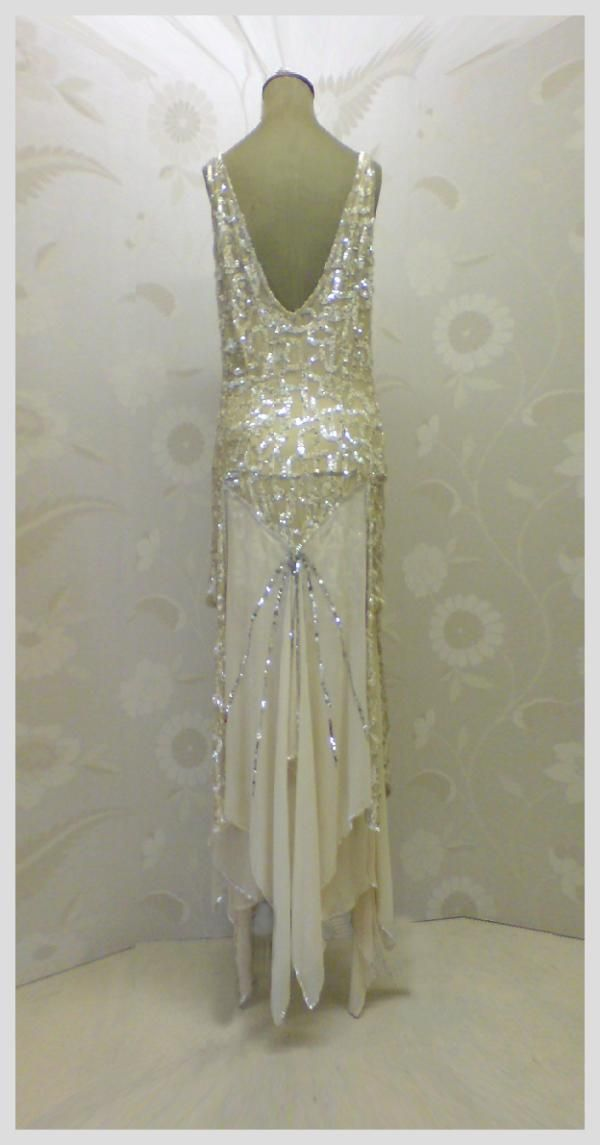 """I don't often post reproductions or """"vintage-inspired"""" pieces, but this beaded Art Deco style evening gown, designed by Joanne Fleming, is too gorgeous not to share!"""