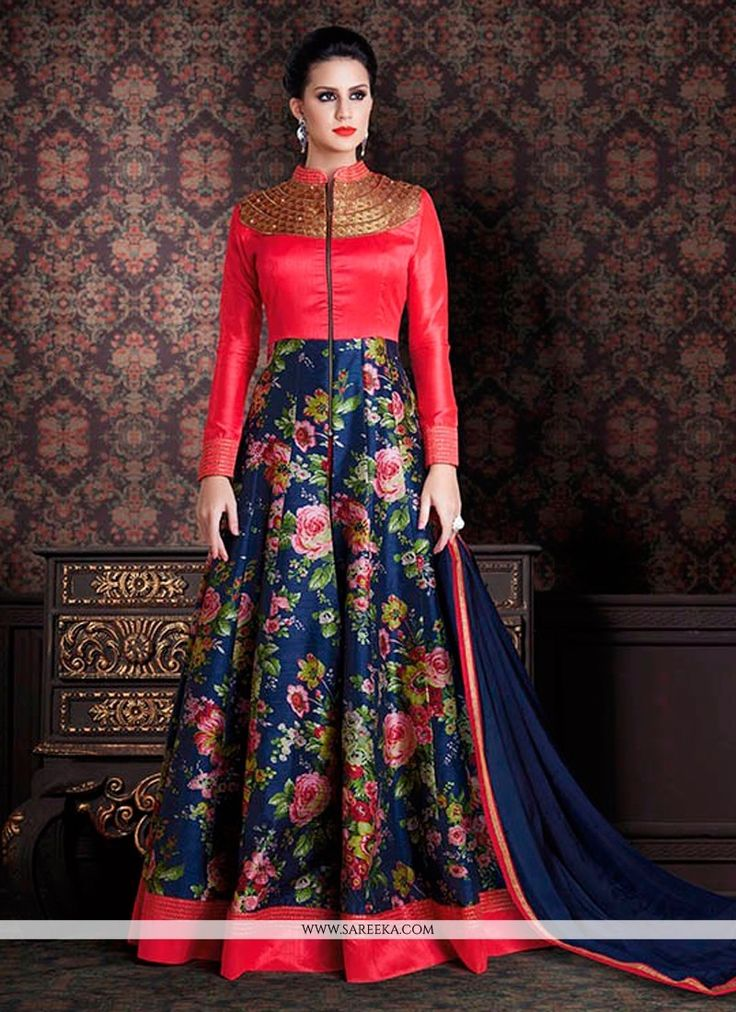 Make the heads turn when you costume up in such a beautiful hot pink and navy blue banarasi silk anarkali salwar kameez. The incredible dress creates a dramatic canvas with wonderful patch border and ...