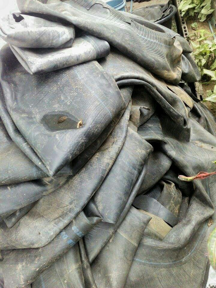 Discarded truck inner tube ready to be cleaned and cut for production.