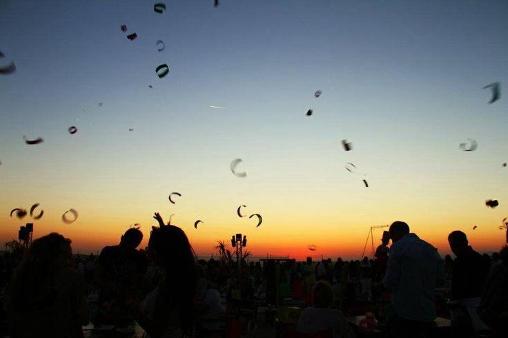 Sunset with kites Singita Miracle Beach Fregene, Rome, Italy beach club, sunset & aperitif