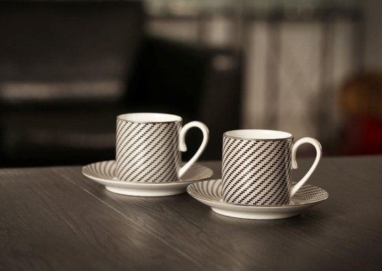 Coffee tastes better in the Carbon Espresso cups. Designed by Grant MacDonald Silversmiths for their Aston Martin Collection.