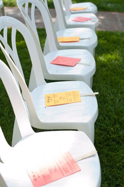 fan programs - awesome idea for and outdoor wedding. I like that they are printed on colored paper!