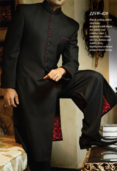 I like this for the groom's sherwani. Black with red details.