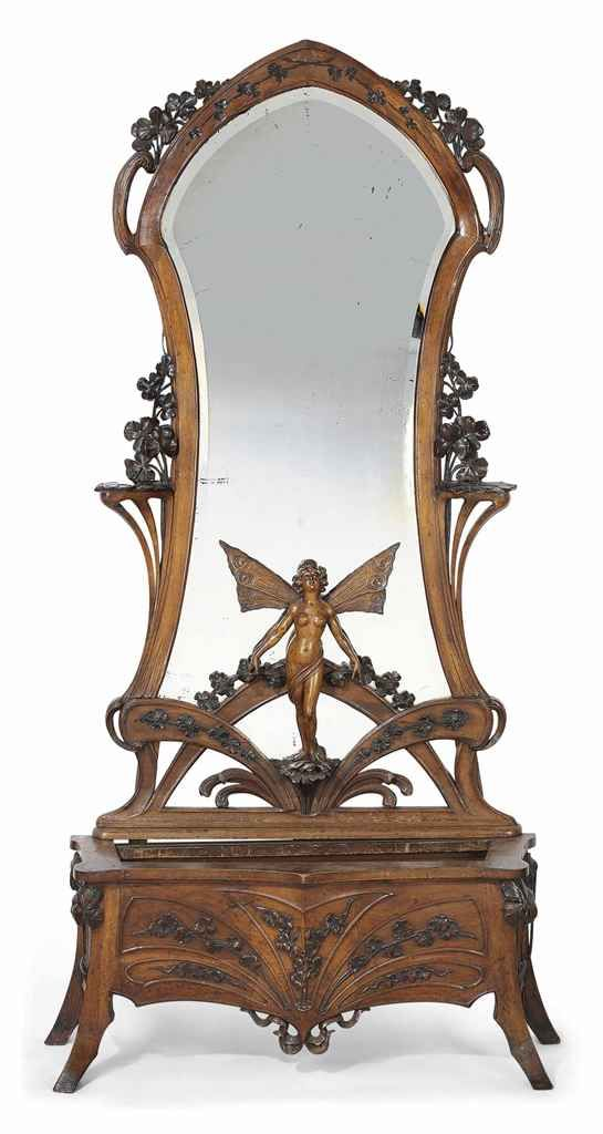 AN ART NOUVEAU CARVED WALNUT SCULPTURAL MIRROR AND JARDINIERE-STAND | PROBABLY ITALIAN, EARLY 20TH CENTURY | European Furniture, Decorative Objects & Early Sculpture Auction | Furniture & Lighting, mirrors | Christie's