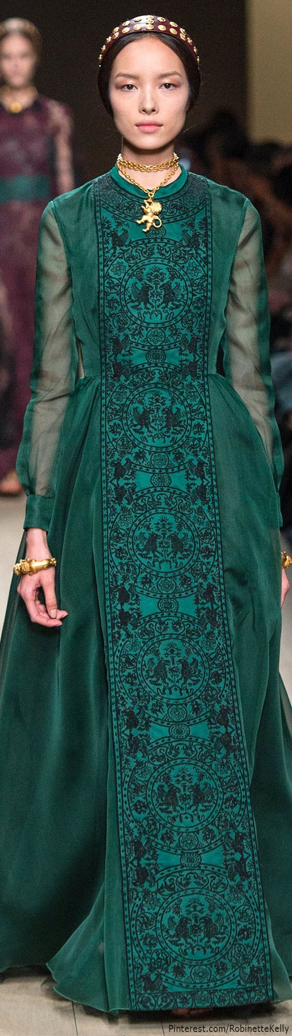 Valentino | S/S 2014 RTW. This resembles the era of the pre-Raphaelite movement in the 19th century. It pulls themes from the medieval period with dark colors and elaborate prints. The conservative neckline resembles the medieval period as well. 1/31/2016.