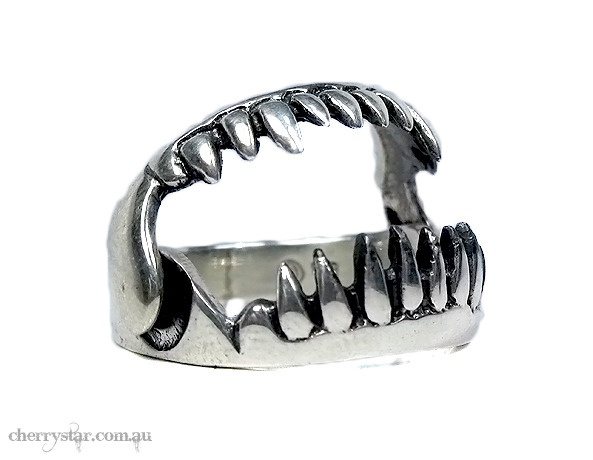 $75.00  Sterling silver hinged Monster Jaw Ring.  Jaw opens and closes and those pointy little teeth are sharp!