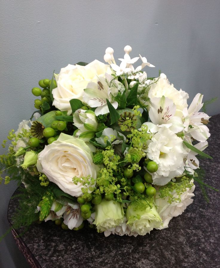 Brides bouquet of creams and greens, relaxed country garden feel with stunning roses