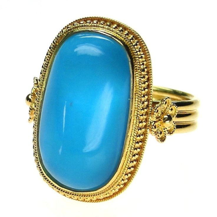 Materials 18k Gold and a Peruvian Opal. Specifics The face is approx 7/8 inch by 1/2 inch. The ring will be made to your size by the designer for a perfect fit. Note This listing features a one-of-a-k