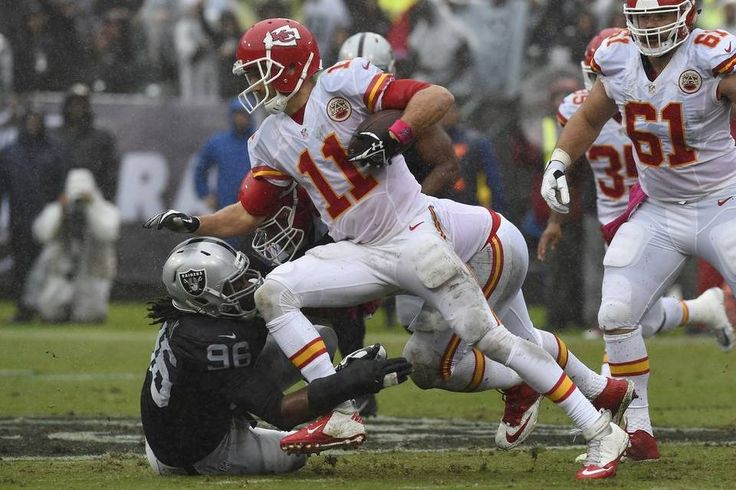 Chiefs vs. Raiders:    October 16, 2016   -  26-10, Chiefs  -     Kansas City Chiefs quarterback Alex Smith (11) is tackled by Oakland Raiders defensive end Denico Autry in the first quarter on Sunday, Oct. 16, 2016 at Oakland Coliseum in Oakland, Calif.