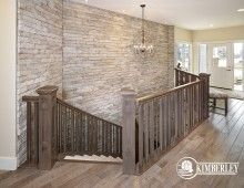 Curved Staircase with stone feature wall. 2014 Cash & Cars for Cancer Lottery Home | The Legacy model by Kimberley Homes   #interiordesign #newhomedesign #homedesign #newhome #customhome #yegre #buildwithkimberley #kimberleyhomes